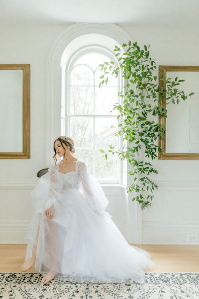 Wedding Officiant in NYC, bride in editorial style image of her next to a window