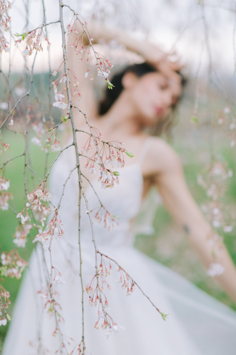 New York Wedding Officiant, Woman standing under a tree in white dress