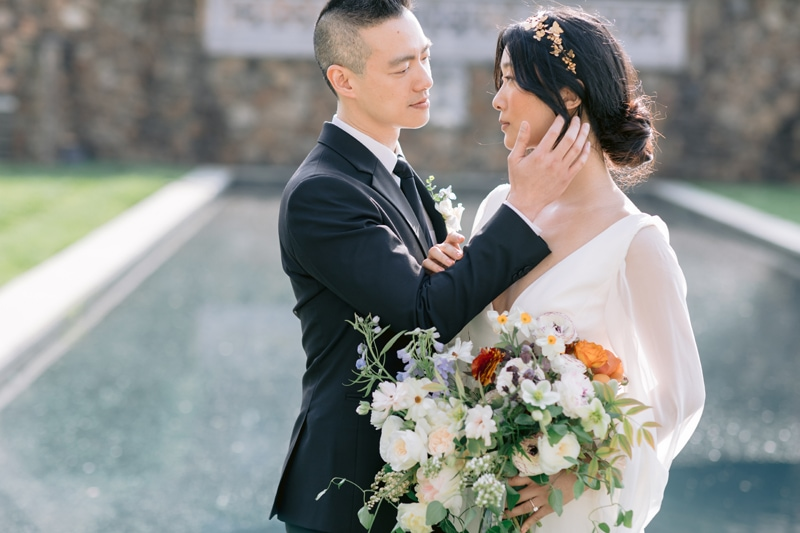 Wedding Officiant in NYC, groom placing his hand on bride's cheek
