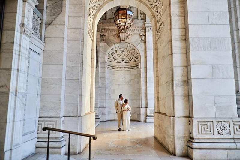 Wedding Officiant in NYC, couple standing in old city hall building with high ceilings