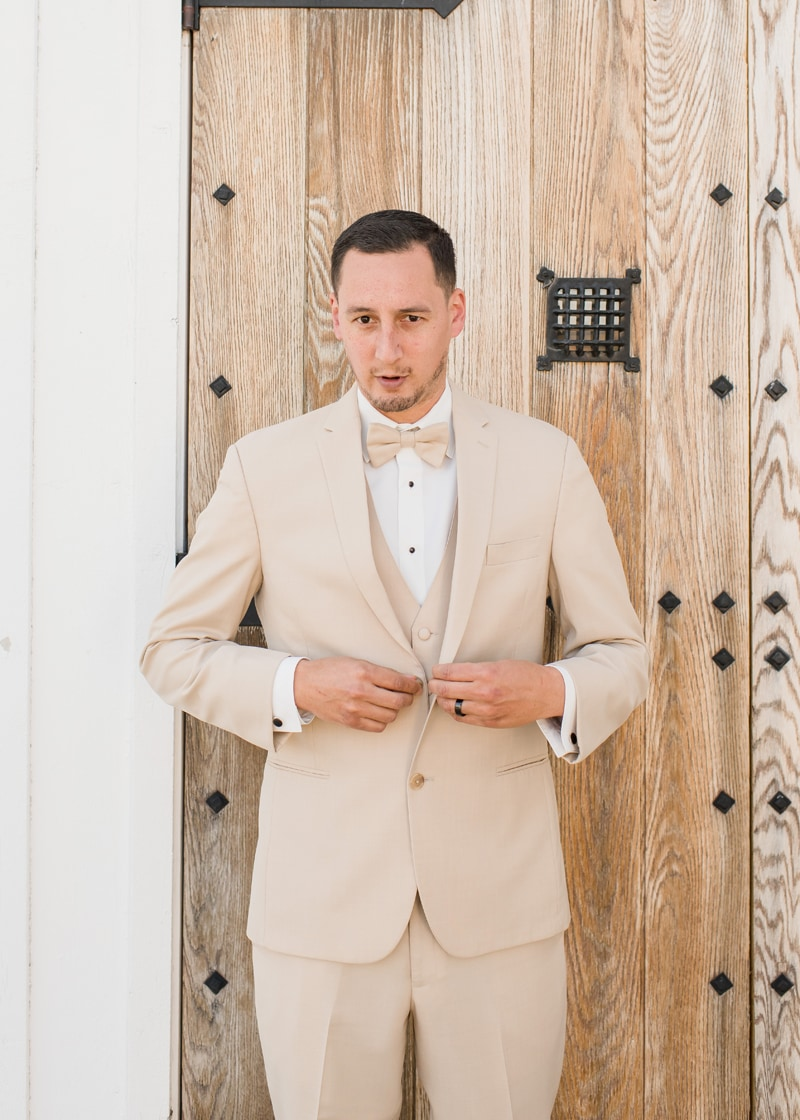 New York Wedding Officiant, groom buttoning his suit jacket